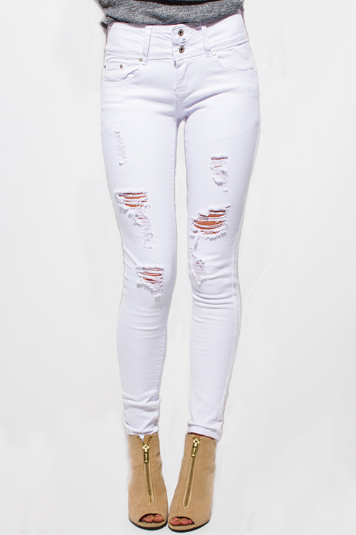 Shop white denim mid rise distressed ripped skinny jeans