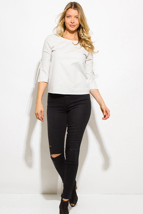 Shop black denim mid rise ripped knee skinny fit ankle jeans