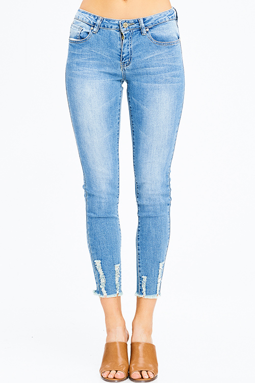 Cute cheap blue washed denim mid rise distressed frayed hem fitted ankle skinny jeans
