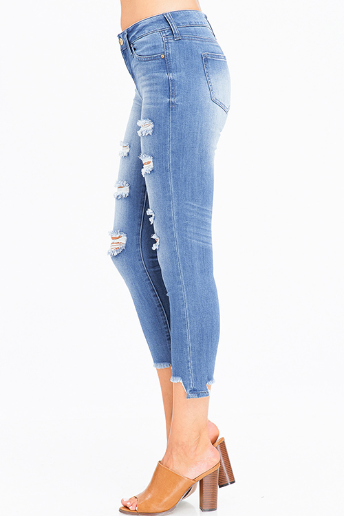 Cute cheap blue washed denim mid rise distressed ripped frayed chewed hem cropped skinny jeans