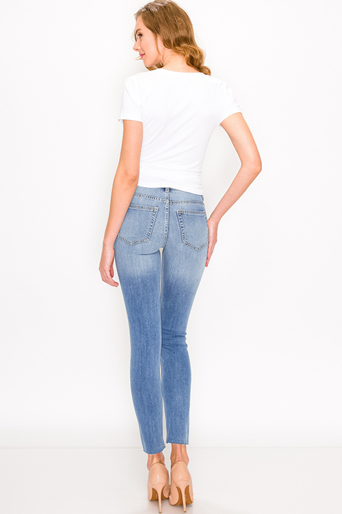 Cute cheap Blue washed denim mid rise distressed ripped knee fitted skinny jeans