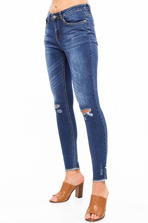 Cute cheap Blue washed denim mid rise distressed ripped knee pearl studded slit hem fitted skinny jeans
