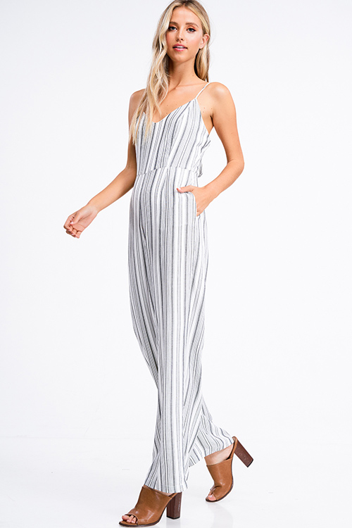 Cute cheap Ivory white striped sleeveless v neck cut out tie back zip up pocketed wide leg boho jumpsuit