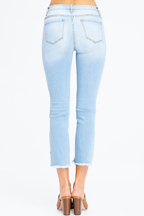 Cute cheap light blue denim mid rise distressed frayed chewed hem fitted skinny jeans