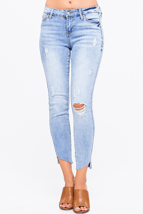 Cute cheap Light blue washed denim mid rise distressed ripped cut out hem fitted skinny jeans