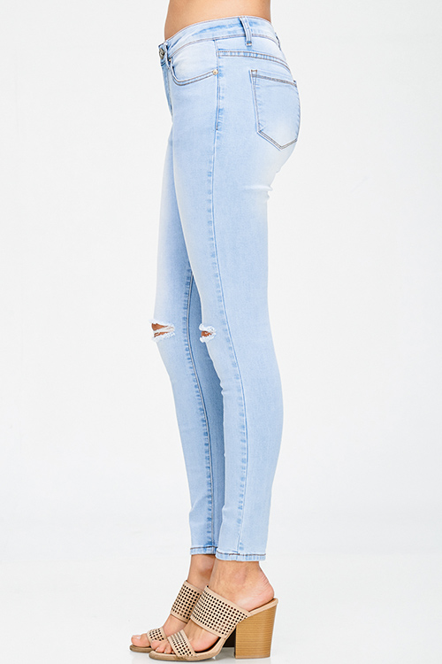 Cute cheap light blue washed denim mid rise distressed ripped knee fitted skinny jeans