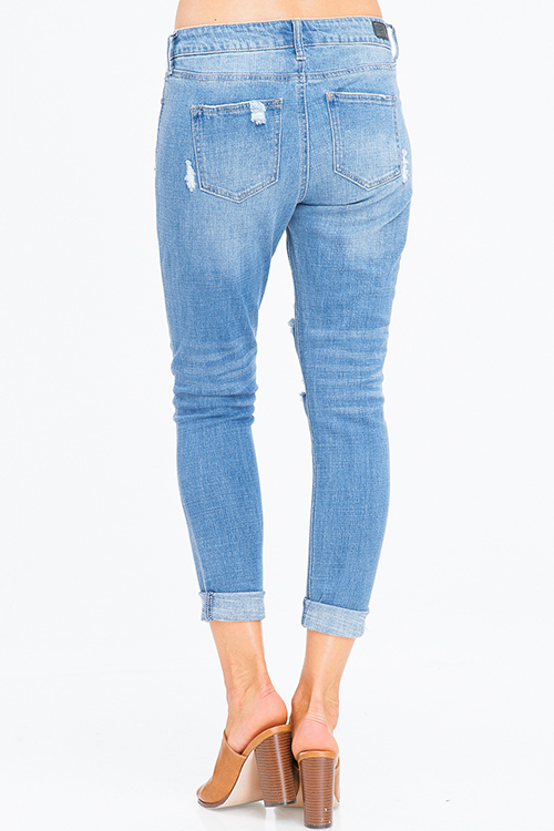 Cute cheap light blue washed denim mid rise distressed ripped rolled hem girlfriend jeans