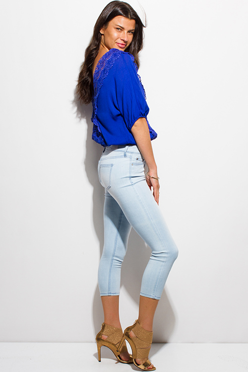 Cute cheap light blue washed denim pocketed mid rise fitted cropped capri skinny jeans