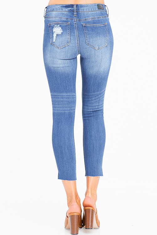 Cute cheap medium blue washed denim mid rise distressed ripped angle cut out hem cropped skinny jeans