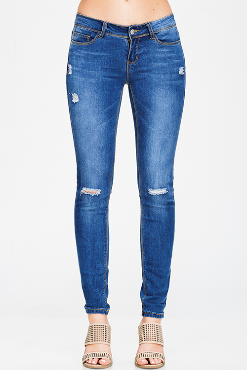 Cute cheap medium blue washed denim mid rise distressed ripped knee fitted skinny jeans