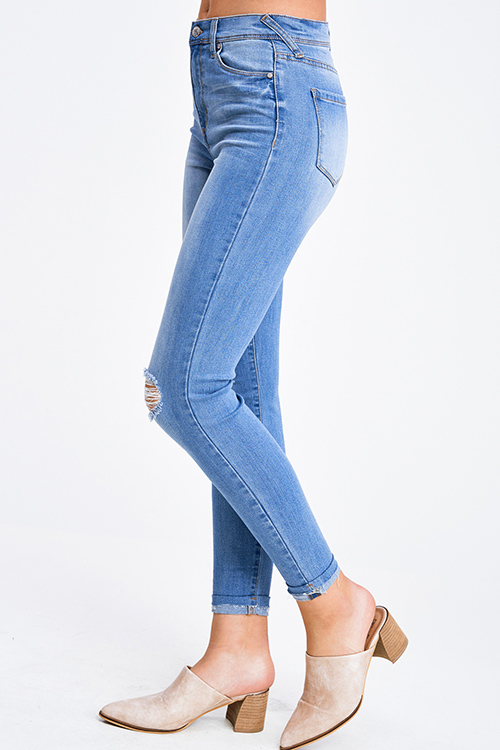 Cute cheap Medium blue washed denim mid rise ripped knee distressed fitted skinny jeans