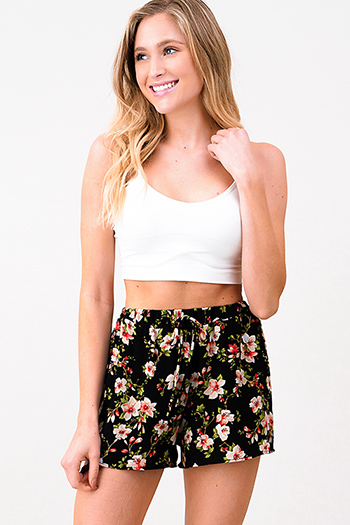 $10 - Cute cheap black floral print ruffle off shoulder pocketed boho wide leg jumpsuit - Black floral print elastic high waist resort lounge boho summer shorts